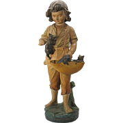 Antique signed French painted terracotta figure Boy with basket of kittens