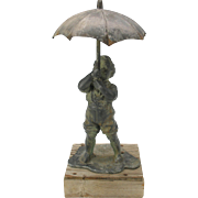 Antique zinc figural garden water sprinkler-little boy with umbrella