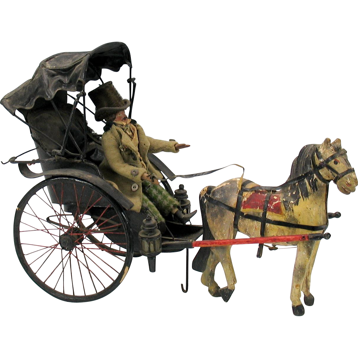 early man doll in beaver top hat riding in horse drawn