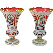 Pair cranberry Bohemian overlay glass vases with decoration 9""