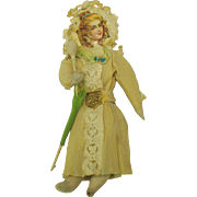 Antique German spun cotton & crepe paper lady with umbrella Christmas ornament
