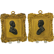 Pair of Grand Tour gilt bronze Classical portrait wall plaques