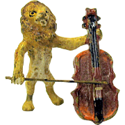 Antique Austrian miniature painted bronze Lion playing Cello