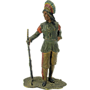 Antique polychrome painted bronze of a Native American Indian holding a rifle