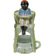 "Rare Black Americana porcelain boy on a high potty chair over chamber pot ""pink pigs"" maker"
