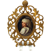 Fine hand painted porcelain portrait plaque in Victorian gilded cast iron frame