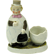 Victorian bisque Man in an EGG suit match holder striker