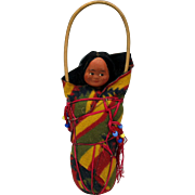 Vintage SKOOKUM Native American baby in a papoose doll