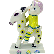 Bizarre 1920's porcelain Metzler & Ortloff figure of a boy riding a spotted anteater antelope pony