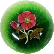 Vintage Francis Whittemore glass paperweight of flower on green ground