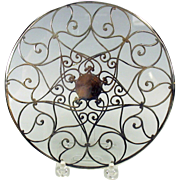 Fancy antique silver overlay glass trivet 7""
