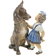 Big Dahl Jensen Copenhagen porcelain figure girl with Alsatian Shepherd puppy and bone