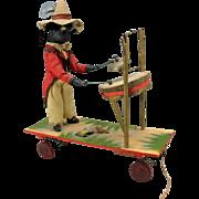 Antique Black boy musician German bisque head automaton platform pull toy