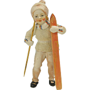 Large antique German snowed bisque figure Girl with skis 5.5 inches tall
