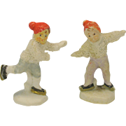 Pair snowed German bisque Ice skaters red caps cake decorations
