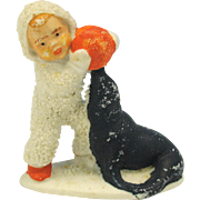 Vintage German bisque Snow baby with seal and ball cake decoration