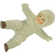 Large vintage German bisque snow baby falling on it's side