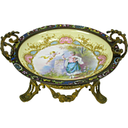 Signed Sevres porcelain bowl in gilt bronze and champleve enamel frame holder