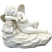 Superbly modeled antique parian porcelain sleeping Cupid or Cherub