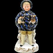 Heubach German bisque figure-boy holding Pug dog puppies
