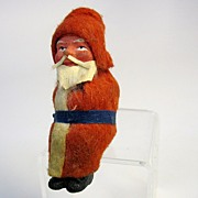 Small vintage German paper mache sleigh sitting Santa Claus      B