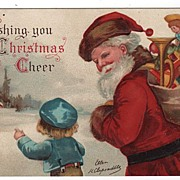 Signed Clapsaddle Christmas Santa with a Bag of Toys Postcard