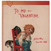 Signed Clapsaddle Valentine postcard Forlorn Little Boy Sitting