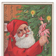 Christmas Postcard with Santa Claus Placing a Doll on a Candlelit Tree