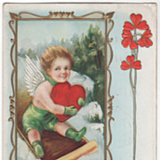 Cupid on Sled with Large Red Heart Rectangle Frame Valentine Vintage Postcard
