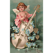 Cupid in Pink Playing a White Bass with an Arrow Vintage Valentine Postcard