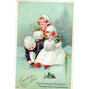 Three Children Getting Ready to Ice Skate in the Snow Vintage Christmas Postcard - Red Tag Sale Item