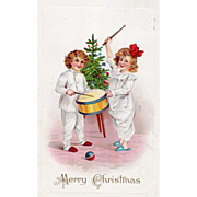 Boy and Girl in Night Clothes Playing a Drum Vintage Christmas Postcard - Red Tag Sale Item