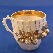 White and Gold Cup with Fruit and Foliage