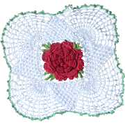 White Doily with Red Rose Center and Green Edging