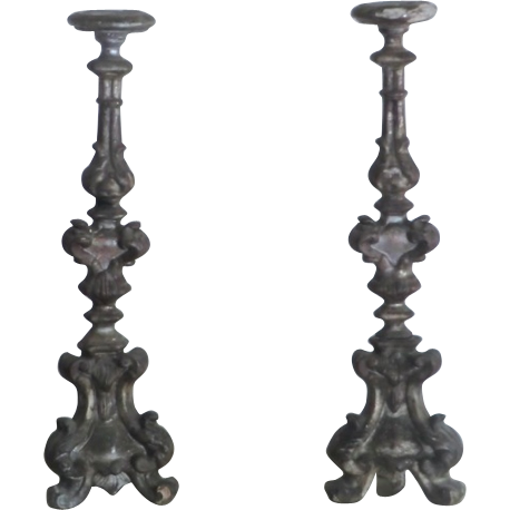 Pair of intricately carved Italian Candlesticks