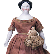 "7 1/2"" (19 cm) Antique All Original German Early Porcelain Doll with miniature Grodnertal wooden child"