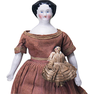 """7 1/2"""" (19 cm) Antique All Original German Early Porcelain Doll with miniature Grodnertal wooden child"""