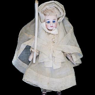 "4"" (11 cm) Antique French All-Bisque Mignonette Doll with original communion dress"