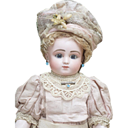 "18"" (46cm) Rare Antique French Bisque Bourgoin Bebe Doll by Jules Steiner Series C with Wire-Lever Sleep Eyes, closed mouth, original dress, c.1882"