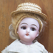"""6"""" (15 cm.)  Antique German All-Bisque Black Stocking Mignonette Doll by Simon and Halbig  in original dress"""