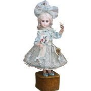 19in (48cm)  Wonderful French Musical Automaton closed mouth Jumeau Bebe Doll with  Fan and Flowers by Leopold Lambert, c.1890
