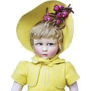"""18"""" (46 cm.)  An Antique All-Original French Cloth Character Girl Doll by Raynal in yellow costume"""