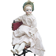 17in (43cm) Antique French Fashion Doll  with bisque hands and legs, in original cotton dress