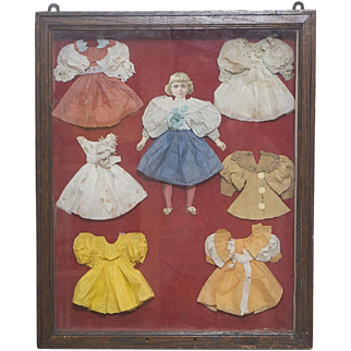 Antique All Original Large Paper doll  and her Trousseau in Wooden Presentation Frame with glass, c.1900.