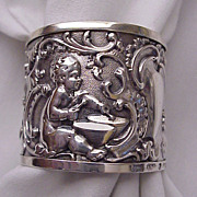 English Sterling Napkin Ring with Cherubs - Birm 1889
