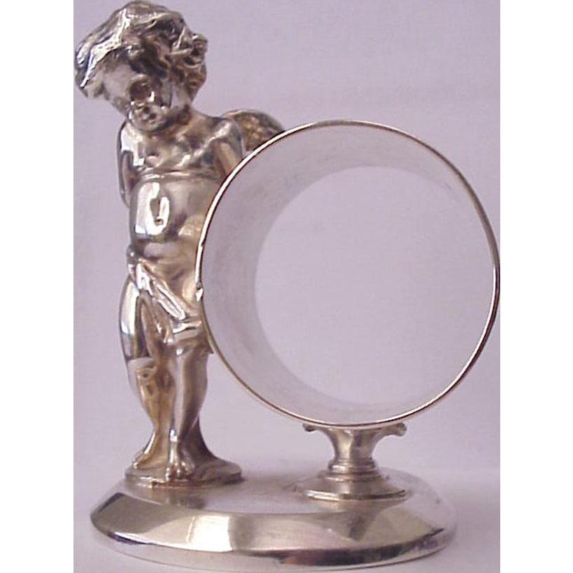 James W. Tufts Quadruple Plate Figural Napkin Ring - Circa 1885