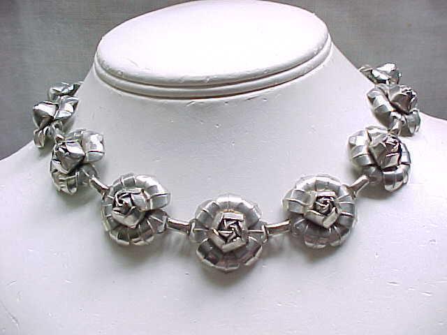 10 - Silvertone Metal Rose Necklace - 14 Roses
