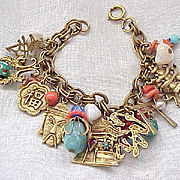 Napier Oriental Themed Charm Bracelet - Many Elements