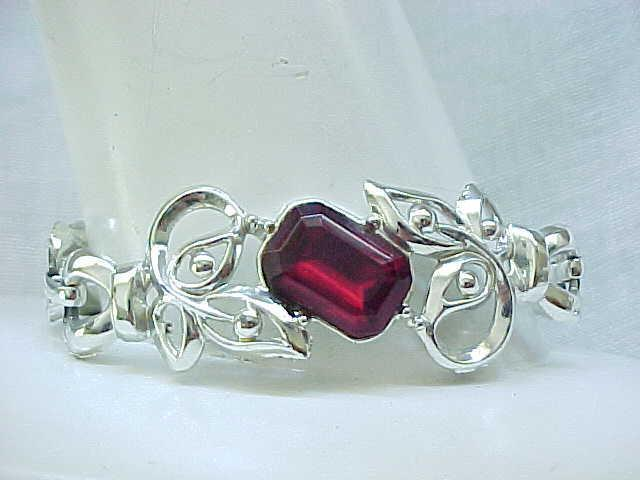 10 - Silvertone Bracelet with Ruby Red Rhinestone Center