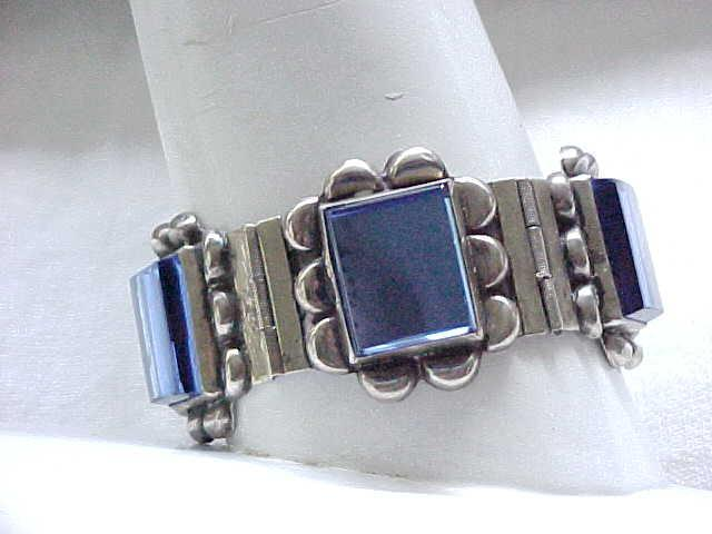 Fab Wide Bracelet with Blue Glass Inserts